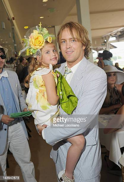 Dannielynn Birkhead and her father Larry Birkhead attend attend the 138th Kentucky Derby at Churchill Downs on May 5 2012 in Louisville Kentucky
