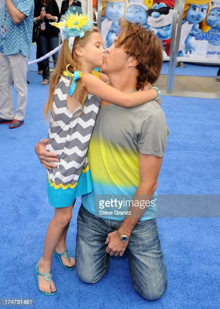 Dannielynn Birkhead and Larry Birkhead arrivies at the Smurfs 2 Los Angeles Premiere at Regency Village Theatre on July 28 2013 in Westwood California
