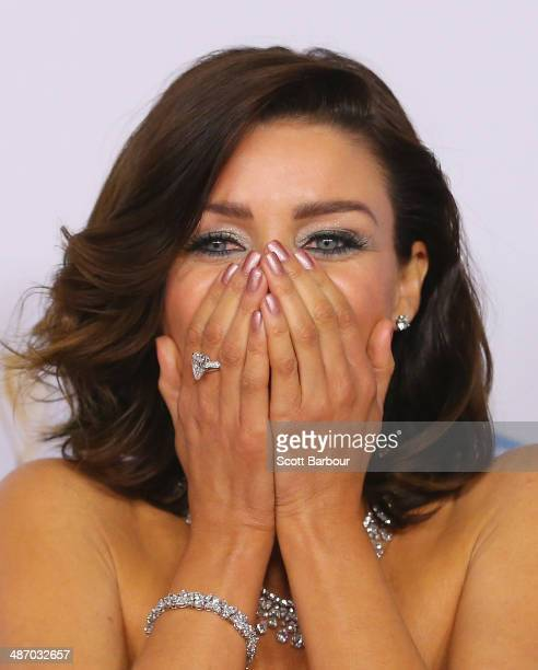 Dannii Minogue laughs as she arrives at the 2014 Logie Awards at Crown Palladium on April 27 2014 in Melbourne Australia