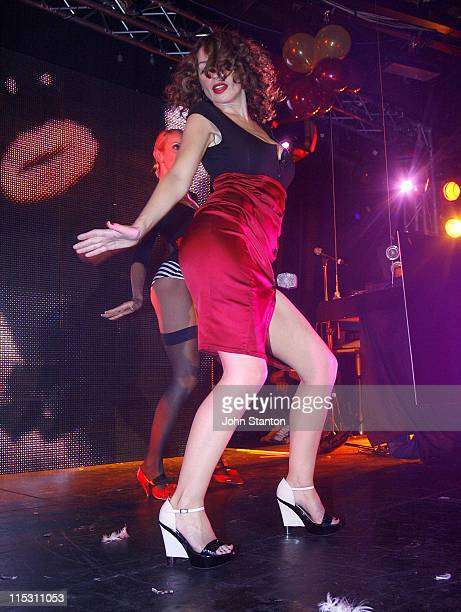 Dannii Minogue performing with dancer during Dannii Minogue in Concert at Home Night Club in Sydney August 17 2006 at Home Nightclub Darling Harbor...