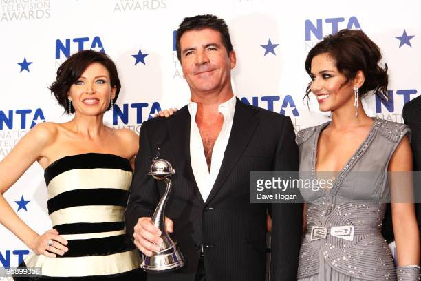 Dannii Minogue, Simon Cowell and Cheryl Cole pose with the most popular talent show award awarded to X Factor in the press room at the National...
