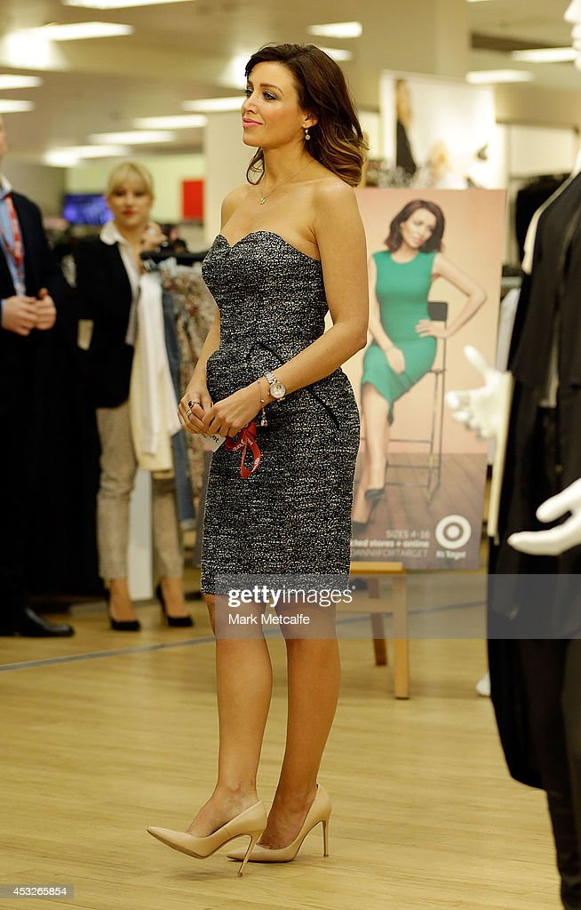 Dannii Minogue speaks to a member of the public at the launch of her Petites range at Target, Bondi Junction on August 7, 2014 in Sydney, Australia.