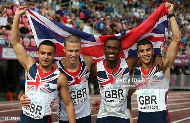 Dannish WalkerKahn Daniel Talbot Deji Tobais and Adam Gemili of Great Britain pose for photographers after winning the Men's 4x100m Relay during day...