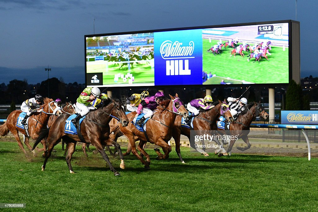 Danny Adam riding Our Nkwazi (2nd L) defeats Damian Oliver riding Prince Harada in Race 9 during Melbourne Racing at Moonee Valley Racecourse on June 6, 2015 in Melbourne, Australia.