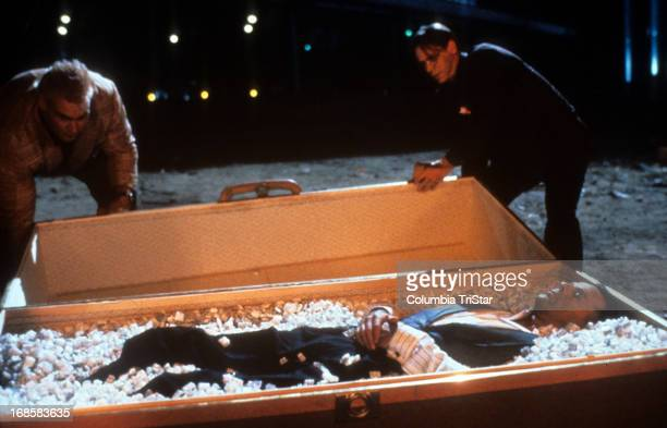 Danny Aiello uncovers Bruce Willis in a casket in a scene from the film 'Hudson Hawk' 1991