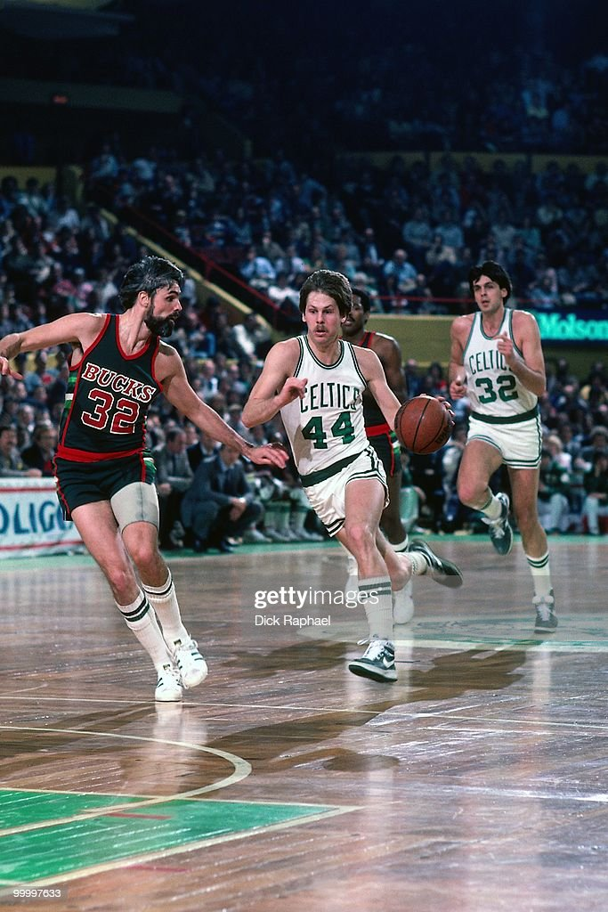 Danny Ainge #44 of the Boston Celtics drives the ball up court against Brian Winters #32 of the Milwaukee Bucks during a game played in 1983 at the Boston Garden in Boston, Massachusetts.