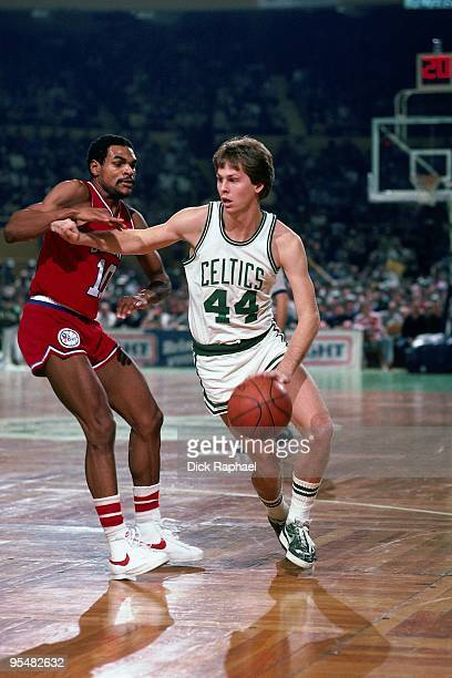 Danny Ainge of the Boston Celtics drives to the basket against Maurice Cheeks of the Philadelphia 76ers during a game played in 1984 at the Boston...