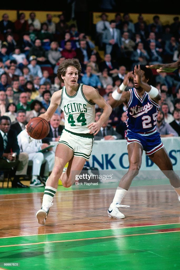 Danny Ainge #44 of the Boston Celtics drives to the basket against the Kansas City Kings during a game played in 1983 at the Boston Garden in Boston, Massachusetts.