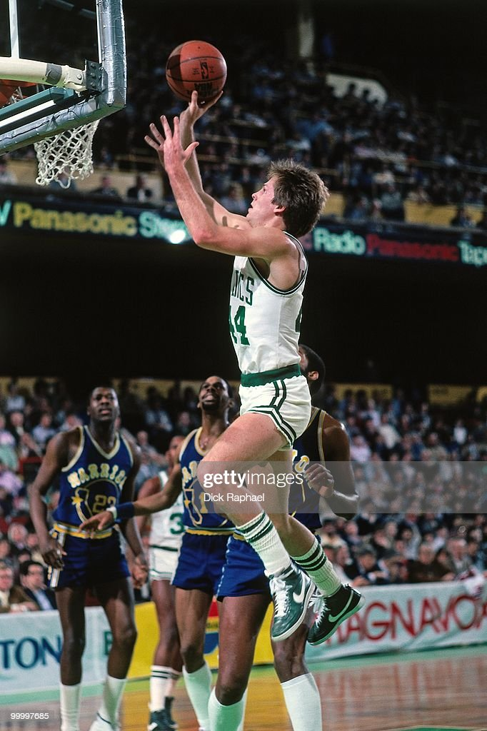 Danny Ainge #44 of the Boston Celtics goes up for a shot against the Golden State Warriors during a game played in 1983 at the Boston Garden in Boston, Massachusetts.