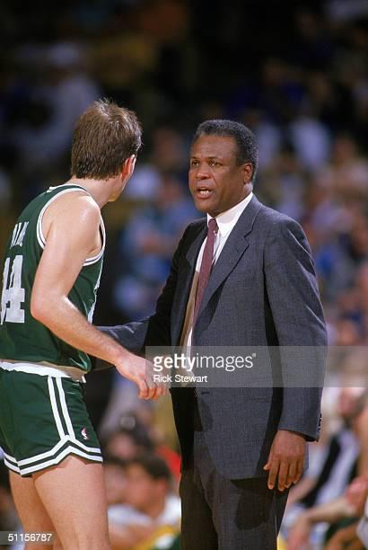 Danny Ainge of the Boston Celtics listens to head coach K.C. Jones during a NBA season game. K.C. Jones was the head coach of the Boston Celtics from...