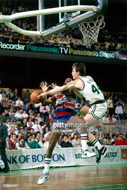 Danny Ainge of the Boston Celtics makes a steal against the Washington Bullets during an NBA game circa 19811989 at the Boston Garden in Boston...