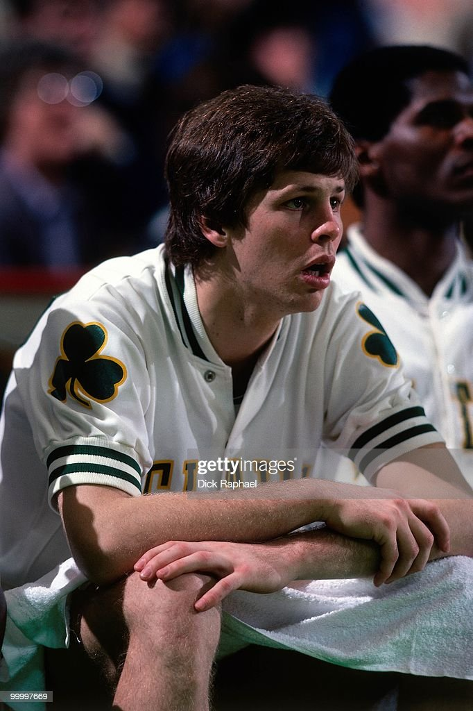 Danny Ainge #44 of the Boston Celtics sits on the bench during a game played in 1983 at the Boston Garden in Boston, Massachusetts.