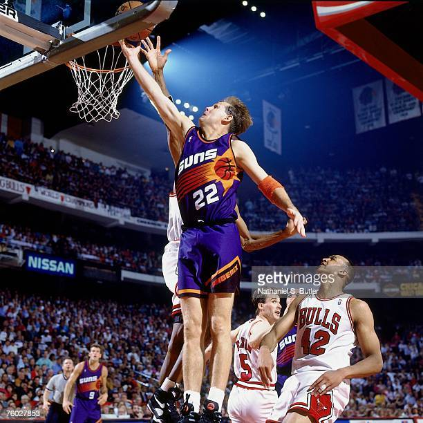 Danny Ainge of the Phoenix Suns attempts a layup against John Paxson of the Chicago Bulls in Game Five of the 1993 NBA Finals on June 18 1993 at the...