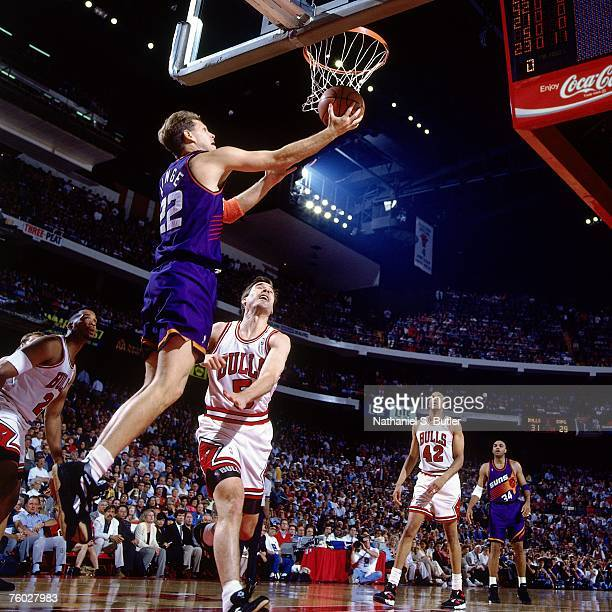 Danny Ainge of the Phoenix Suns attempts a layup against John Paxson of the Chicago Bulls in Game Four of the 1993 NBA Finals on June 16 1993 at the...