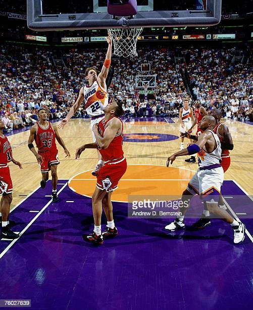Danny Ainge of the Phoenix Suns attempts a layup against Sean Williams of the Chicago Bulls in Game Two of the 1993 NBA Finals on June 11 1993 at the...