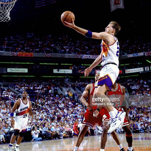 Danny Ainge of the Phoenix Suns attempts a layup against the Chicago Bulls in Game One of the 1993 NBA Finals on June 9 1993 at the America West...
