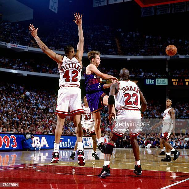 Danny Ainge of the Phoenix Suns attempts a pass against Scott Williams and Michael Jordan of the Chicago Bulls in Game Three of the 1993 NBA Finals...