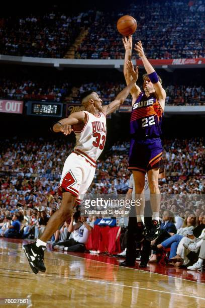 Danny Ainge of the Phoenix Suns attempts a shot against Scottie Pippen of the Chicago Bulls in Game Three of the 1993 NBA Finals on June 13 1993 at...