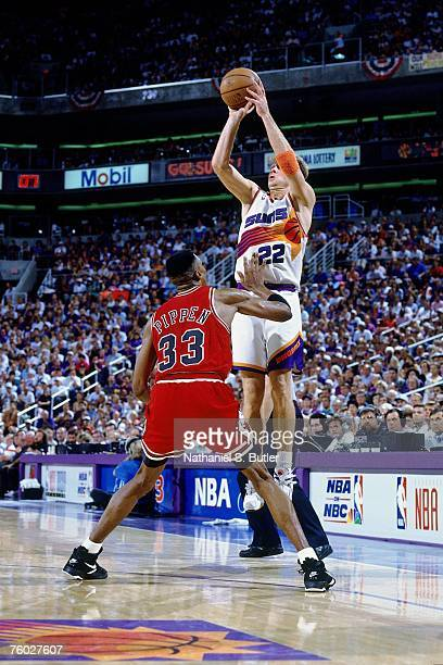 Danny Ainge of the Phoenix Suns attempts a shot against Scottie Pippen of the Chicago Bulls in Game Two of the 1993 NBA Finals on June 11 1993 at the...