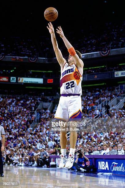 Danny Ainge of the Phoenix Suns attempts a shot against the Chicago Bulls in Game Two of the 1993 NBA Finals on June 11 1993 at the America West...