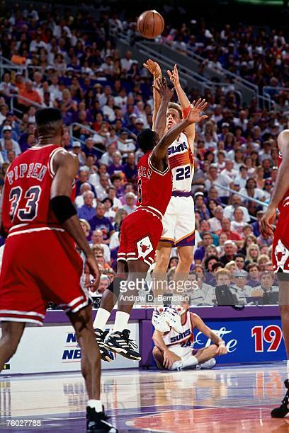 Danny Ainge of the Phoenix Suns attempts a shot against the Chicago Bulls in Game Six of the 1993 NBA Finals on June 20 1993 at th America West Arena...