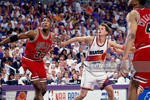 Danny Ainge of the Phoenix Suns battles for position against Scottie Pippen of the Chicago Bulls in Game Six of the 1993 NBA Finals on June 20 1993...