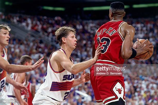 Danny Ainge of the Phoenix Suns defends Scottie Pippen of the Chicago Bulls in Game Two of the 1993 NBA Finals on June 11 1993 at the America West...