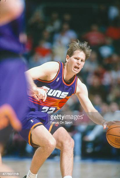 Danny Ainge of the Phoenix Suns dribbles the ball against the Washington Bullets during an NBA basketball game circa 1993 at the Capital Centre in...