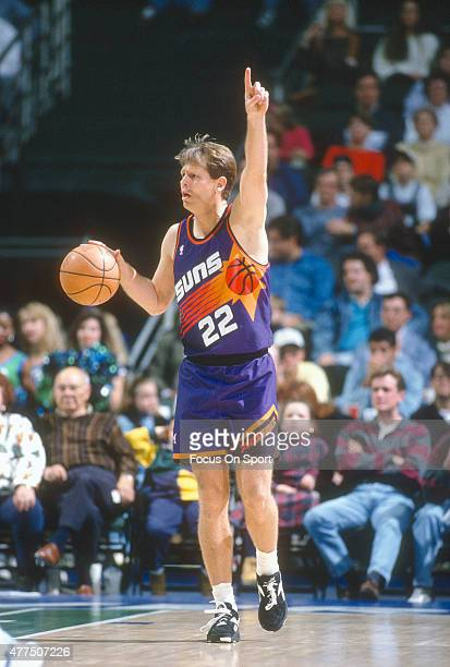 Danny Ainge of the Phoenix Suns dribbles the ball up court against the Dallas Mavericks during an NBA basketball game circa 1993 at the Reunion Arena...