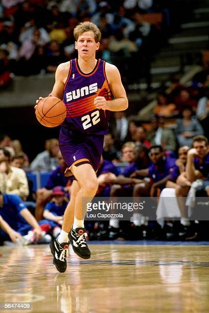Danny Ainge of the Phoenix Suns dribbles up court against the New Jersey Nets during an NBA game at Brendan Byrne Arena in 1993 in East Rutherford...