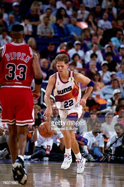 Danny Ainge of the Phoenix Suns dribbles upcourt against Scottie Pippen of the Chicago Bulls in Game One of the 1993 NBA Finals on June 9 1993 at the...