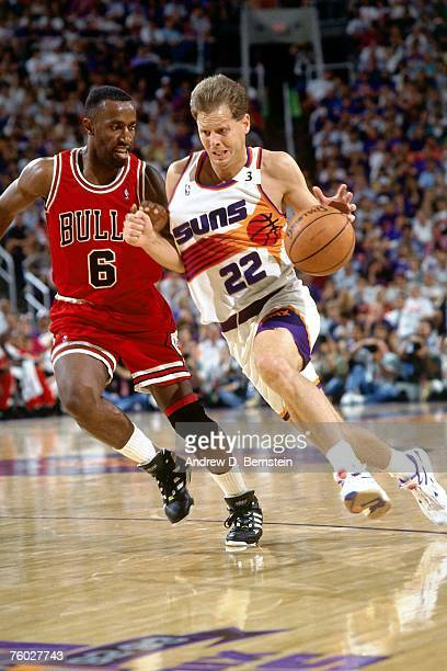 Danny Ainge of the Phoenix Suns drives to the basket against the Chicago Bulls in Game One of the 1993 NBA Finals on June 9 1993 at the America West...