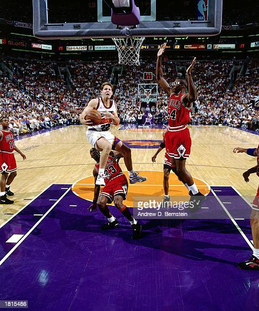 Danny Ainge of the Phoenix Suns drives to the basket for a layup against the Chicago Bulls in Game Two of the 1993 NBA Championship Finals at America...