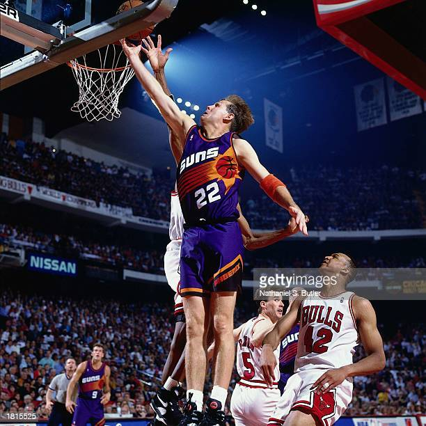 Danny Ainge of the Phoenix Suns goes for layup against the Chicago Bulls during Game Five of the 1993 NBA Championship Finals at Chicago Stadium on...