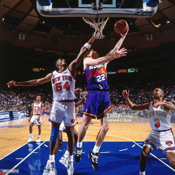 Danny Ainge of the Phoenix Suns goes to the basket against the New York Knicks circa 1993 at Madison Square Garden in New York City NOTE TO USER User...