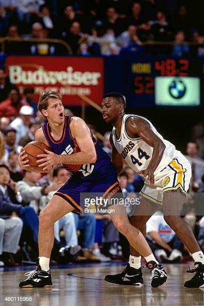 Danny Ainge of the Phoenix Suns handles the ball against the Golden State Warriors during a game played in 1993 at the OaklandAlameda County Coliseum...