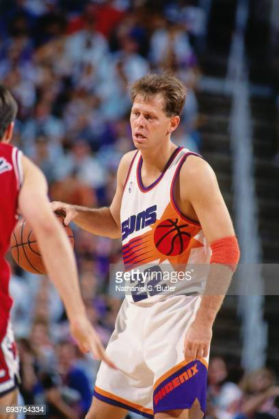 Danny Ainge of the Phoenix Suns handles the ball during the game against the Chicago Bulls during Game Two of the 1993 NBA Finals on June 11 1993 at...