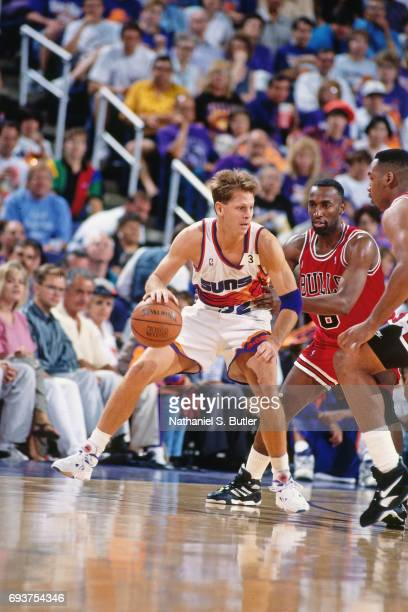 Danny Ainge of the Phoenix Suns handles the ball during the game against the Chicago Bulls during Game One of the 1993 NBA Finals on June 9 1993 at...