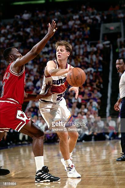 Danny Ainge of the Phoenix Suns makes a pass against the Chicago Bulls during Game One of the 1993 NBA Championship Finals at America West Arena on...