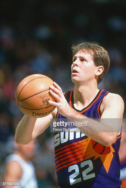 Danny Ainge of the Phoenix Suns sets to shoot a free throw against the Washington Bullets during an NBA basketball game circa 1993 at the Capital...