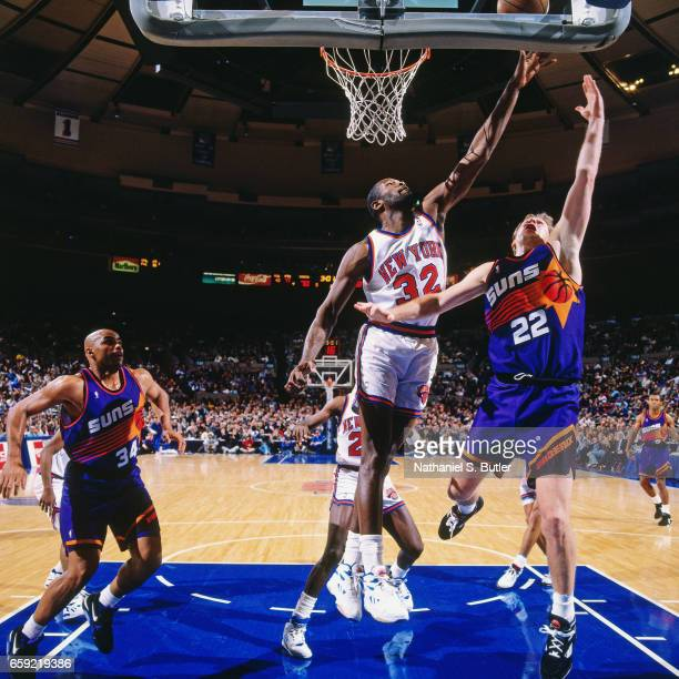 Danny Ainge of the Phoenix Suns shoots against Herb Williams of the New York Knicks during a game played circa 1993 at the Madison Square Garden in...