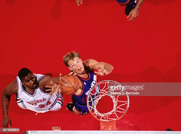 Danny Ainge of the Phoenix Suns shoots against the Los Angeles Clippers circa 1993 at the LA Sports Arena in Los Angeles California NOTE TO USER User...