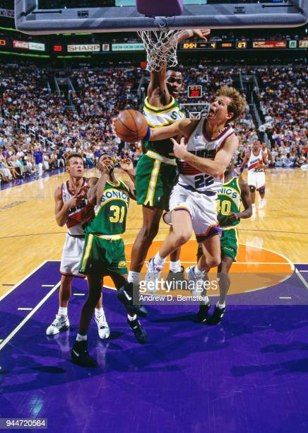 Danny Ainge of the Phoenix Suns shoots the ball against the Seattle SuperSonics during game 1 of the 1993 Western Conference Finals on May 24 1993 at...