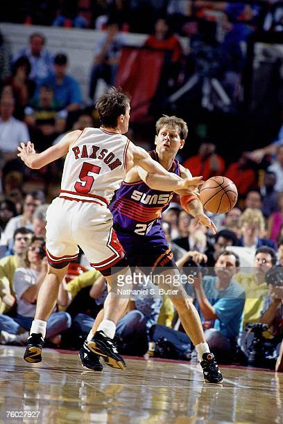 Danny Ainge of the Phoenix Suns throws a pass against John Paxson of the Chicago Bulls in Game Five of the 1993 NBA Finals on June 18 1993 at the...