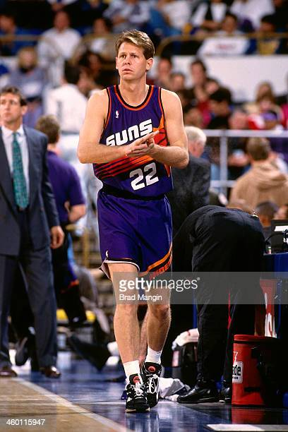 Danny Ainge of the Phoenix Suns walks against the Golden State Warriors during a game played in 1993 at the OaklandAlameda County Coliseum Arena in...