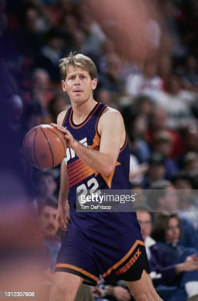 Danny Ainge, Shooting Guard and Point Guard for the Phoenix Suns dribbles the basketball down court during the NBA Midwest Division basketball game...