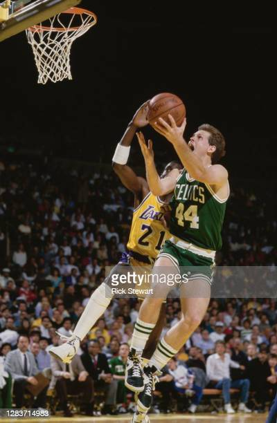 Danny Ainge, Shooting Guard for the Boston Celtics drives to the basket with Michael Cooper of the Los Angeles Lakers during their NBA Pacific...