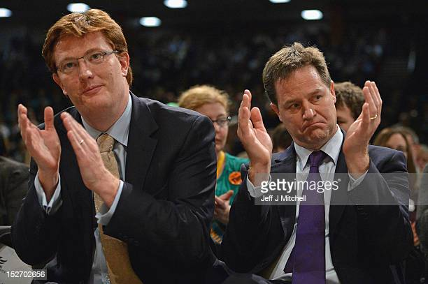 Danny Alexander Chief Secretary to the Treasury and Nick Clegg the Deputy Prime Minster applaud a speech by Jo Swinston at the Liberal Democrat...