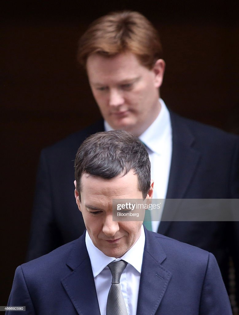 Danny Alexander, U.K. chief secretary to the treasury, top, and George Osborne, U.K. chancellor of the exchequer, leave 11 Downing Street in London, U.K., on Wednesday, March 18, 2015. U.K. unemployment fell to its lowest level in more than six years and real pay growth accelerated in a boost for Osborne as he prepares to announce his final budget before the election. Photographer: Chris Ratcliffe/Bloomberg via Getty Images