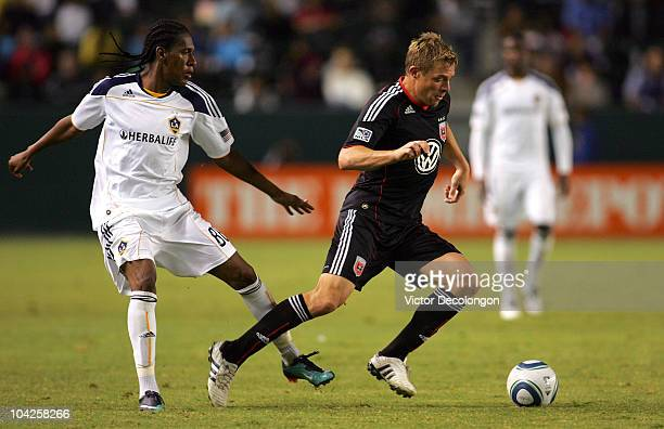 Danny Allsop of DC United plays the ball from Alex Cazumba of the Los Angeles Galaxy in the second half during their MLS match at The Home Depot...